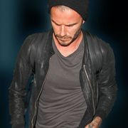 Jacket, Sleeve, Cap, Facial hair, Elbow, Cool, Beard, Flash photography, Leather, Beanie,