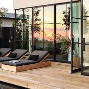 modern deck with glass windows and pool