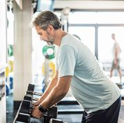 dedicated mature man exercising in a gym