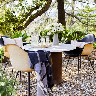 Table, Furniture, Tree, Tablecloth, Chair, Outdoor table, Room, Woodland, Recreation, Event,