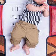 baby on herschel diaper changing pad
