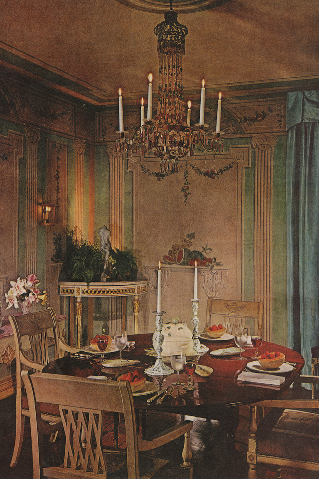dining room with traditional chandelier over circle table