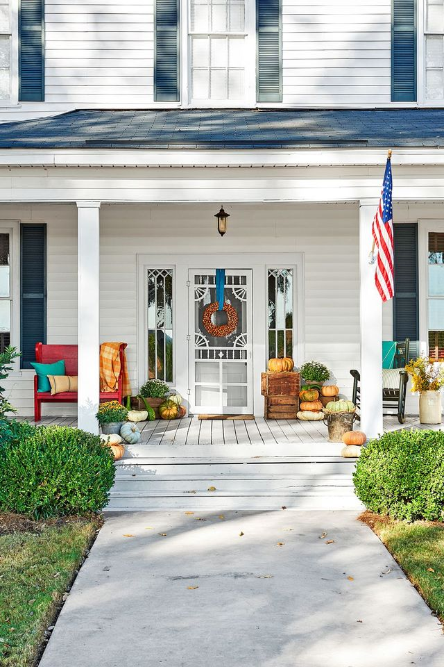 home, property, building, house, residential area, porch, real estate, flag, architecture, door,