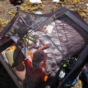 couple in double sleeping bag inside tent