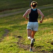 woman running down hill