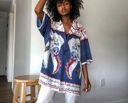 Clothing, White, Blue, Fashion, Shoulder, Visual arts, Outerwear, Sleeve, Fashion design, Textile,