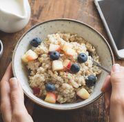 eating healthy breakfast oatmeal porridge in bowl