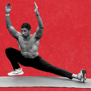 fitness director ebenezer samuel in the bottom position of a cossack squat, hands driven overhead, core held tight