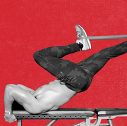 man doing  a resistance band dragon flag with a bench and miniband