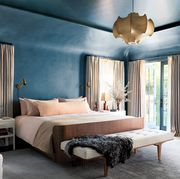 bedroom with blue walls and tall windows