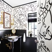 bathroom with black and white illustrated mural on walls