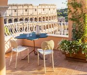 terrace with view of the roman colosseum