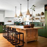 green kitchen with wooden center island