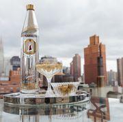 Tower block, Bottle, Cityscape, Metropolitan area, Liquid, Logo, Barware, Alcoholic beverage, Skyscraper, Metropolis,
