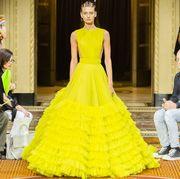 Fashion, Dress, Haute couture, Gown, Fashion model, Yellow, Clothing, Event, Fashion design, Wedding dress,