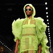 Fashion, Eyewear, Runway, Fashion design, Fashion show, Yellow, Performance, Sunglasses, Human, Event,
