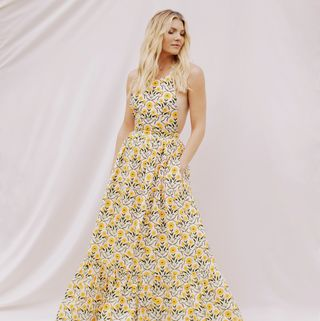 amanda kloots in a yellow floral dress
