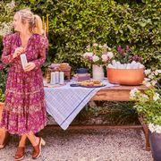 emily henderson in backyard garden with table