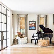contemporary entryway with black grand piano