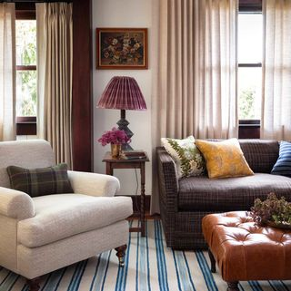 contemporary living room with plaid fabric decorated for fall