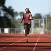 hiit training, high intensity interval training, a female athlete runs on a track