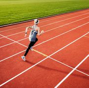 fitness enthusiast running on outdoor track