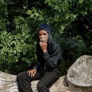 Sitting, Botany, Photography, Outerwear, Footwear, Tree, Headgear, Black hair, Photo shoot, Leisure,
