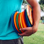 person holding frisbee golf discs