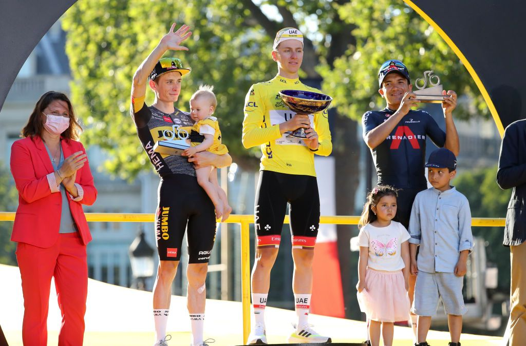 Jonas Vingegaard, second from left, on the podium after finishing second at the Tour de France.
