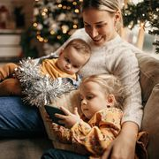 mother waiting for christmas at home with her childrens
