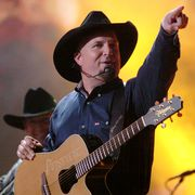 garth brooks performs good ride cowboy during the 39th annual cma awards   garth brooks performs in times square at times square in new york city, new york, united states photo by j kempinfilmmagic