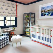 gender neutral nursery with blue and red color scheme