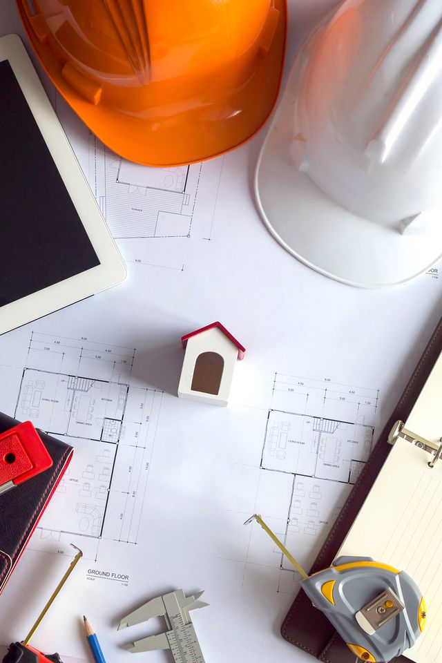 Engineer and Architect concept, Engineer Architects and real estate agent office desk.