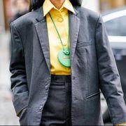 Clothing, Street fashion, Suit, Outerwear, Blazer, Yellow, Fashion, Jacket, Overcoat, Formal wear,