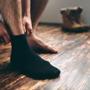 the man wears black socks mens style