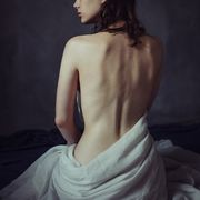 a woman with her back turned to the camera, no shirt on
