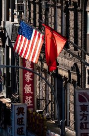 topshot   a us and chinese flag are seen in chinatown on october 14, 2019 in new york city photo by johannes eisele  afp photo by johannes eiseleafp via getty images
