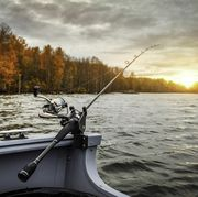 fishing rod on the boat, sunset time beautiful autumn colors a fishing rod is a long, flexible rod used by fishermen to catch fish