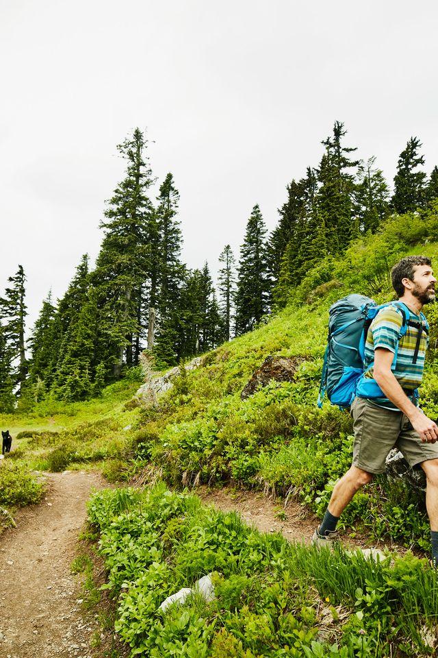 man hiking wilderness