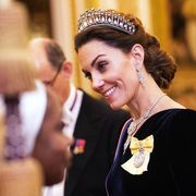 l0ndon, england   december 11 catherine, duchess of cambridge talks to guests at an evening reception for members of the diplomatic corps at buckingham palace on december 11, 2019 in london, englandphoto by victoria jones   wpa poolgetty images
