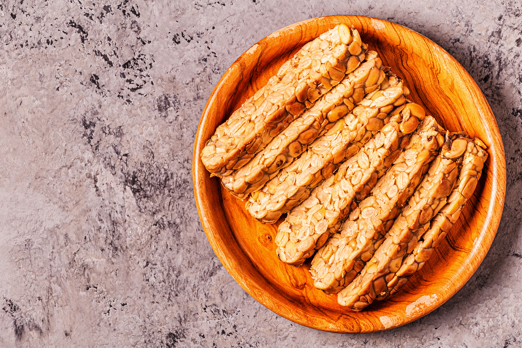 tempeh on wooden plate