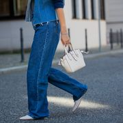 berlin, germany   june 02 jacqueline zelwis is seen wearing 7 for all mankind x marques almeida denim jacket, white cropped top zara, levis jeans, agl shoes, furla bag on june 02, 2021 in berlin, germany photo by christian vieriggetty images