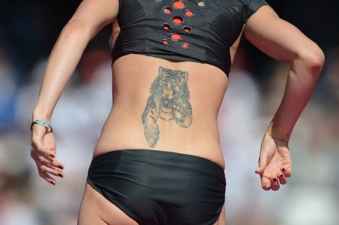 germany's ariane friedrich's tattoo as she competes in the women's high jump qualifying rounds at the athletics event during the london 2012 olympic games on august 9, 2012 in london