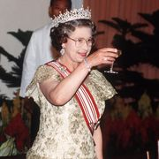 singapore   october 10  the queen making a toast at a banquet during an official tour of singapore prime minister lee kuan yew is standing next to her  photo by tim graham photo library via getty images