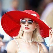 Eyewear, Sunglasses, Red, Hat, Clothing, Street fashion, Lip, Glasses, Sun hat, Beauty,