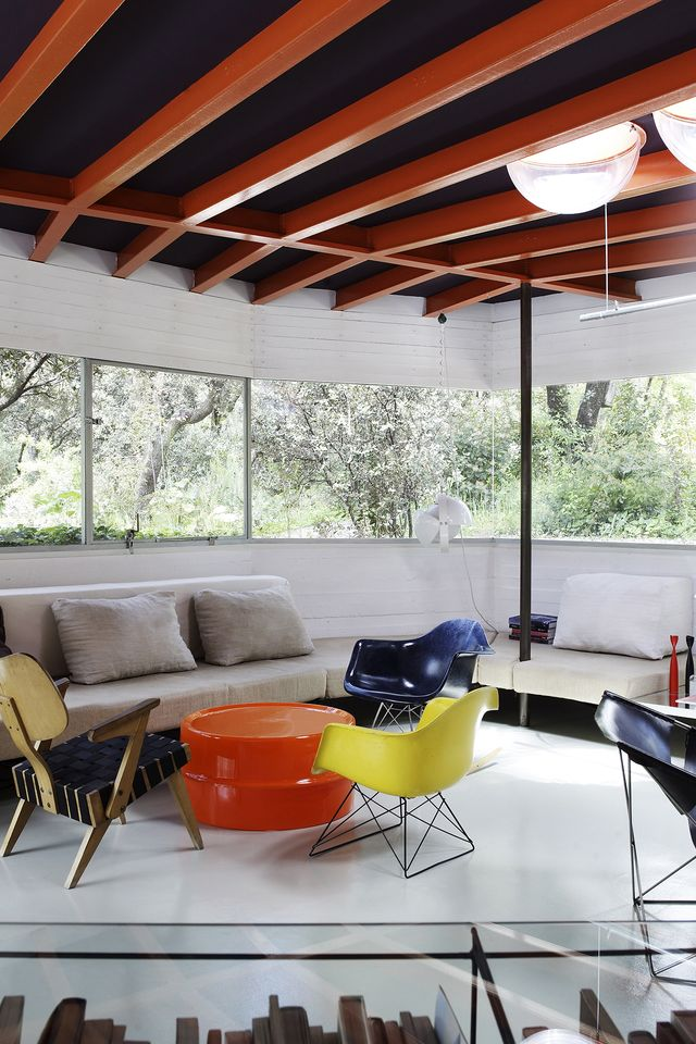 Designer furniture seating in contemporary living room in Spanish home