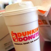 chicago   september 07   a cup of dunkin donuts coffee and a donut bag sit on a counter september 7, 2006 in chicago, illinois in an effort to compete with starbucks in the lucrative coffee market, dunkin donuts has announced a goal of opening more than 10,000 new stores in the us by 2020  photo by tim boylegetty images