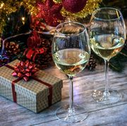 Close-Up Of Wineglasses With Christmas Decoration On Table