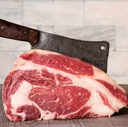 raw prime rib beef with meat cleaver