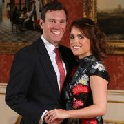 britains princess eugenie of york r poses with her fiance jack brooksbank in the picture gallery at buckingham palace in london on january 22, 2018, after the announcement of their engagement   britains princess eugenie of york wears a dress by erdem, shoes by jimmy choo and a ring containing a padparadscha sapphire surrounded by diamonds britains princess eugenie of york has got engaged, buckingham palace announced january 22, 2018, lining up a second royal wedding this year at the church where prince harry will tie the knot photo by jonathan brady  pool  afp        photo credit should read jonathan bradyafp via getty images